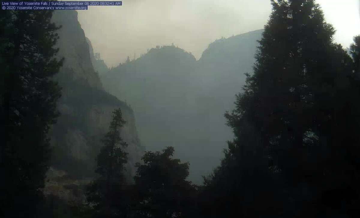 Smoke obscures the view of Yosemite Falls on Sept. 6, 2020, due to the Creek Fire.