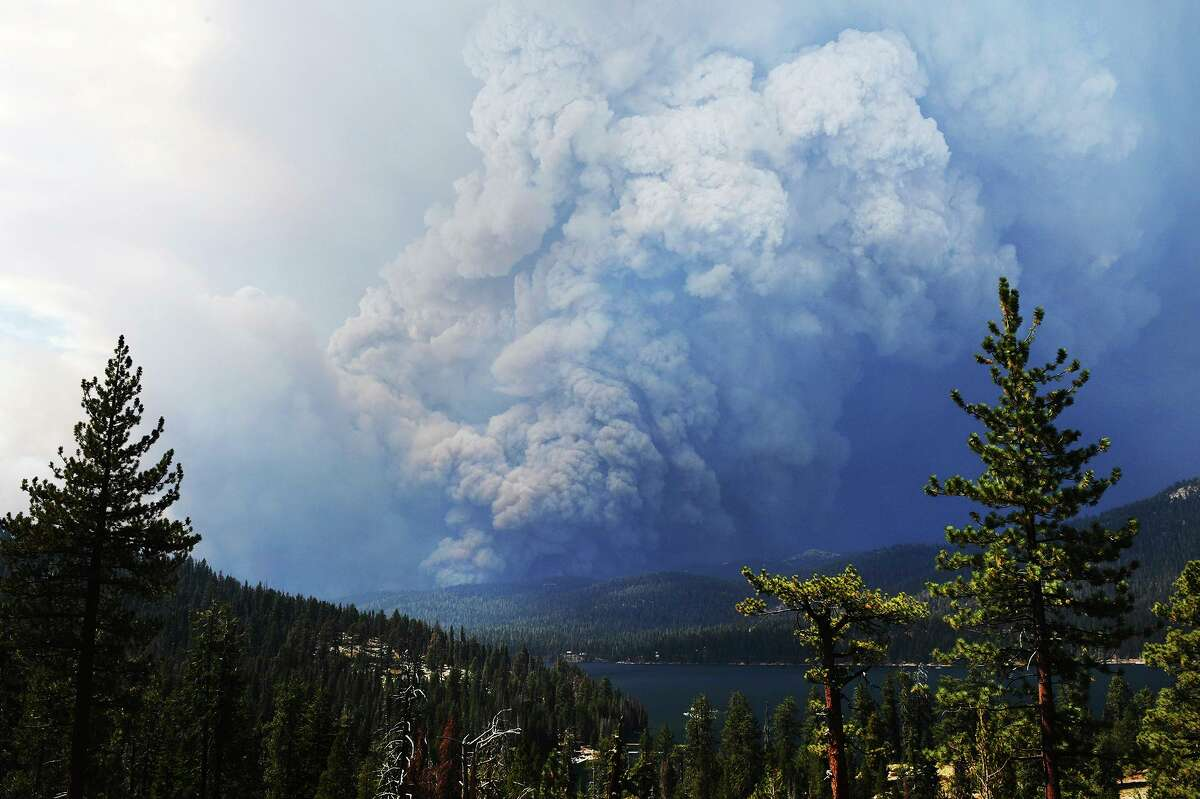 The Creek Fire burns near Huntington Lake on Saturday. The blaze has contributed to concerns over the state's power grid by shutting down a Madera County power station.