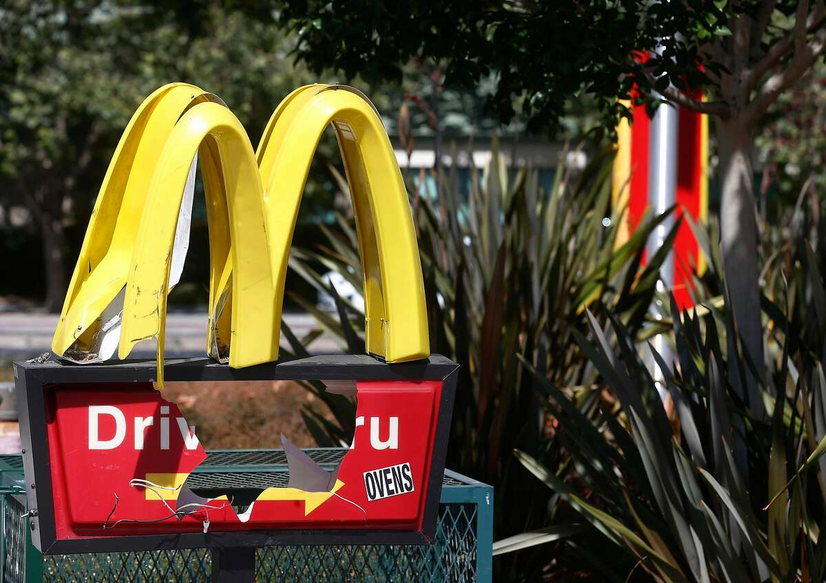 A McDonald's restaurant is shuttered at Telegraph Avenue and 45th Street Oakland, Calif. on Wednesday, July 1, 2020. Health officials ordered the fast food restaurant to shut down after several employees contracted the COVID-19 coronavirus.