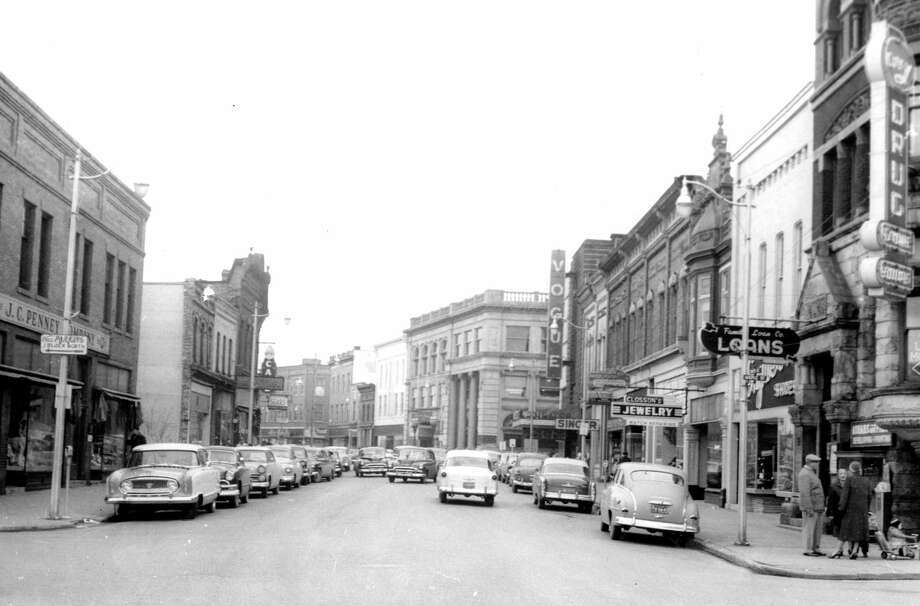 This view shows a look at River Street at the intersection of Maple Street circa 1950s. (Manistee County Historical Museum photo)