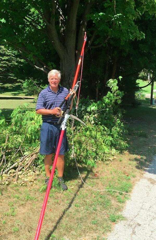 Volunteer Mike Viilo helps the Frankfort Tree Board with trimming city trees after attending a tree-trimming workshop. (Courtesy Photo)