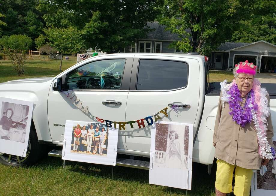 Family, friends and first responders helped Dorothy Holmes have a birthday celebration on Sunday afternoon in Manistee. Photo: Arielle Breen/News Advocate
