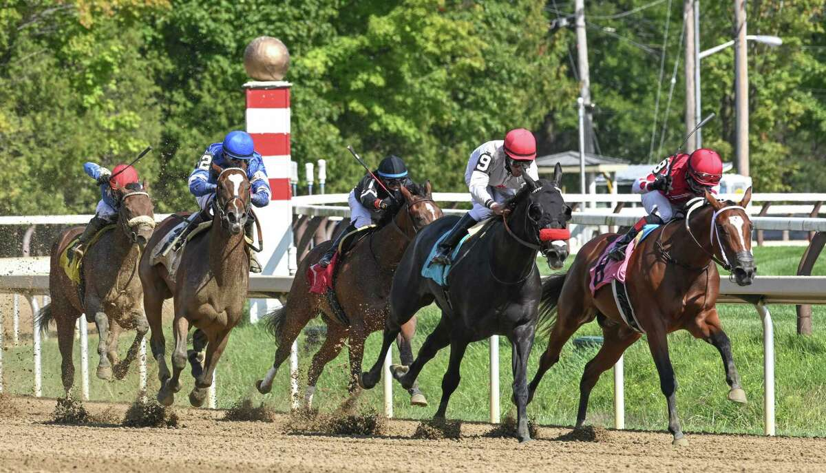 Godolphin Stable's Jane Grey (2) moves toward the leaders on the turn of the seven-furlong fifth race that she went on to win on Sunday, September 6 at Saratoga Race Course in Saratoga Springs, N.Y. (Mike Kane/Special to the Times Union)