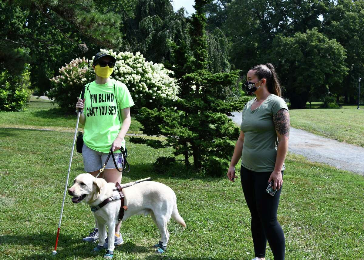 Megan Hale and Samantha Gartland, a mobility specialist at Northeastern Association of the Blind at Albany, have both tested out software created by Microsoft to assist the blind while participating in the sport of trail orienteering. A test run was held Aug. 25, 2020 in Albany's Washington Park. (Joyce Bassett / Special to the Times Union)