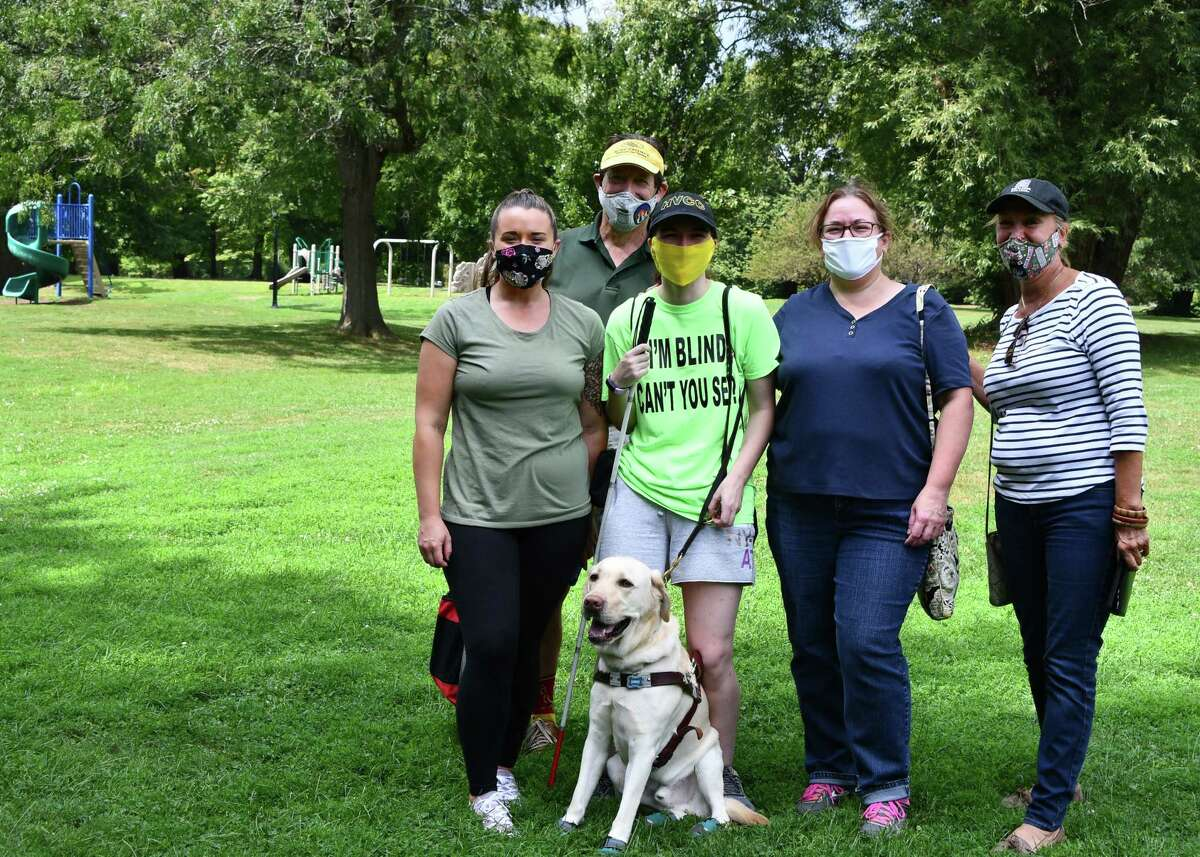 Washington Park in Albany served as a scenic testing ground on Aug. 25, 2020 for software created by Microsoft and being refined for use in the paralympic sport of trail orienteering. The testing team includes, from left, Samantha Gartland, a mobility specialist at Northeastern Association of the Blind at Albany; Russ Myer, Capital Region Nordic Alliance Executive Director; Megan Hale of West Sand Lake; Hale's mom Corrine; and Karen Fagan, a volunteer at Capital Region Nordic Alliance. (Joyce Bassett /Special to the Times Union)