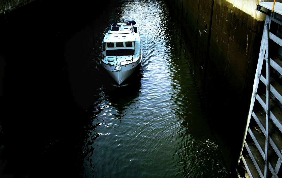 A boat is piloted out of lock 5 on the Erie Canal on Sunday, Sept. 6, 2020, in Cohoes, N.Y. (Paul Buckowski/Times Union)