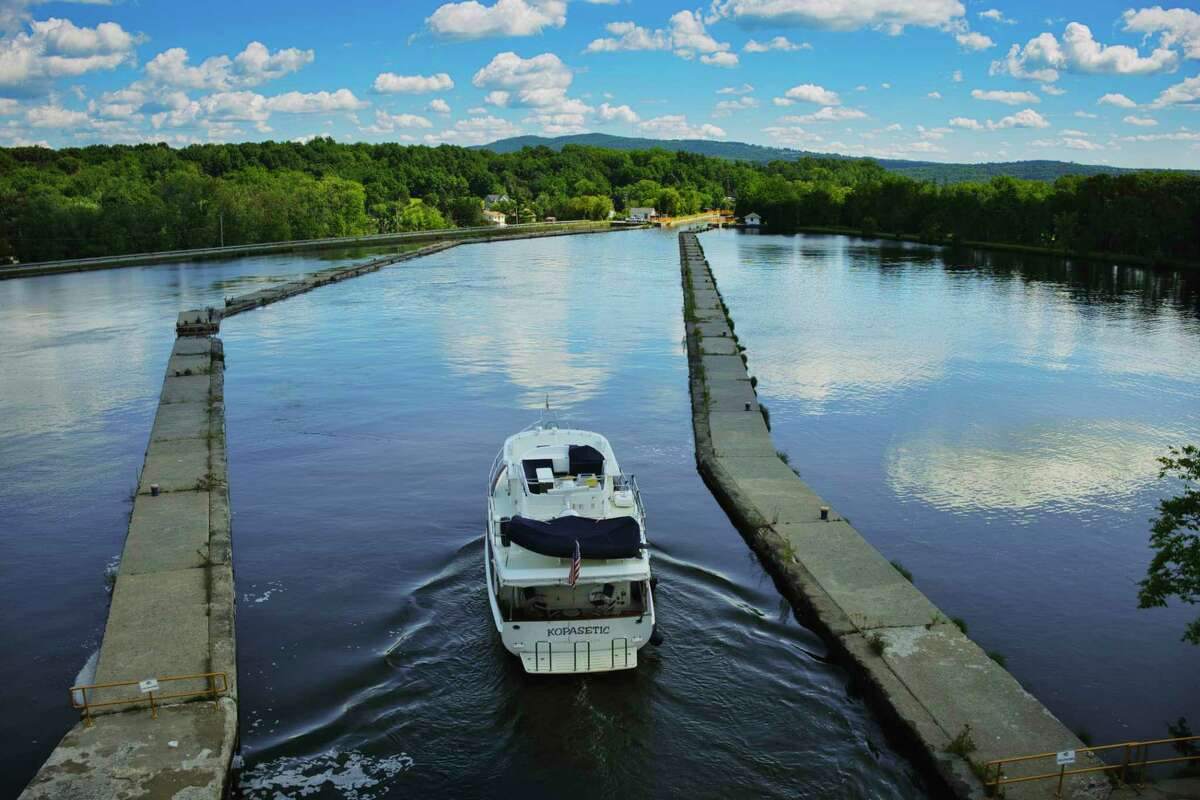 A boat is piloted out of lock 5 and towards lock 4 on the Erie Canal on Sunday, Sept. 6, 2020, in Cohoes, N.Y. (Paul Buckowski/Times Union)