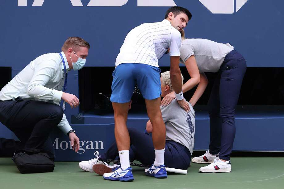 NEW YORK, NEW YORK - SEPTEMBER 06: Novak Djokovic of Serbia tends to a line judge who was hit with the ball during his Men's Singles fourth round match against Pablo Carreno Busta of Spain on Day Seven of the 2020 US Open at the USTA Billie Jean King National Tennis Center on September 6, 2020 in the Queens borough of New York City. Photo: Al Bello, Getty Images / 2020 Getty Images