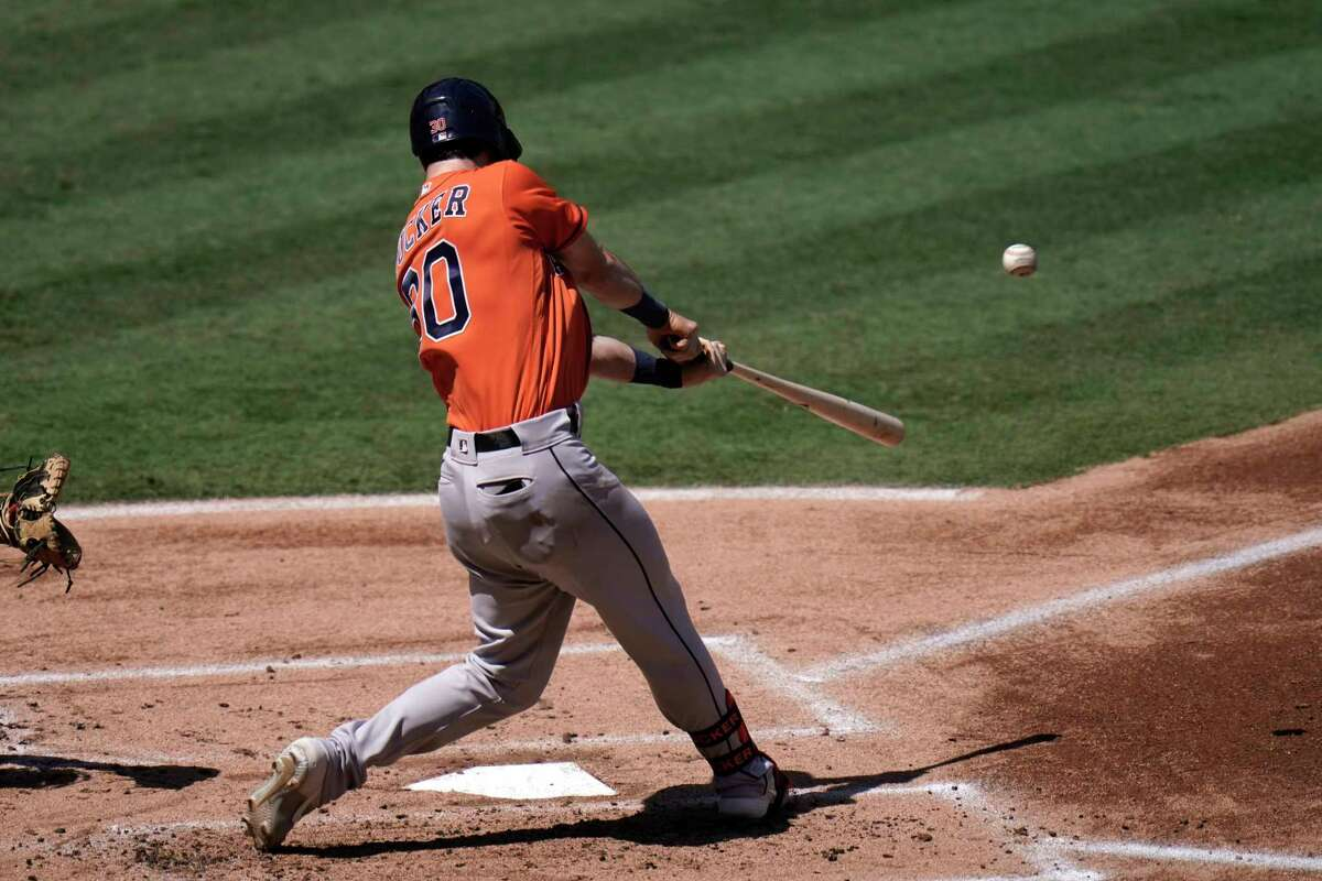 Houston Astros' Kyle Tucker connects with a two-run home run during the first inning of a baseball game against the Los Angeles Angels, Sunday, Sept. 6, 2020, in Anaheim, Calif. (AP Photo/Jae C. Hong)