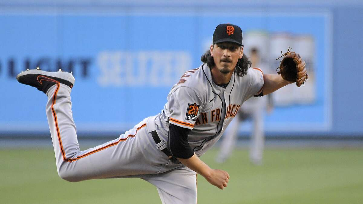 San Francisco Giants starting pitcher Jeff Samardzija throws to the plate during the first inning of a baseball game against the Los Angeles Dodgers Friday, Aug. 7, 2020, in Los Angeles. (AP Photo/Mark J. Terrill)