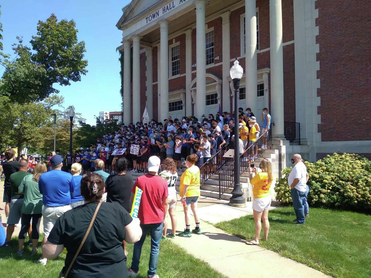 Football players rally at Town Hall in West Hartford on Sunday demanding a Connecticut high school football season.