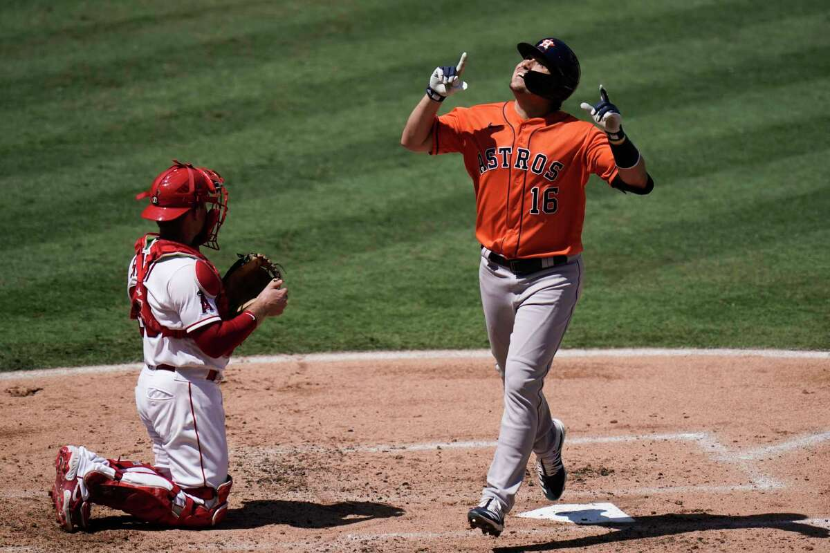Houston Astros' Aledmys Diaz points upward while celebrating his home run during the second inning of a baseball game against the Los Angeles Angels, Sunday, Sept. 6, 2020, in Anaheim, Calif. (AP Photo/Jae C. Hong)