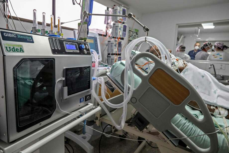 An emergency ventilator is tested on a person at the Intensive Care Unit (ICU) for non COVID patients of the San Vicente Fundacion Hospital in Medellin, Colombia on August 13, 2020. - The city of Medellin sponsored the design and development of low cost emergency ventilators to be used in case the ICUs reach their maximum capacity or in remote places with no access to ICU, amid de COVID-19 pandemic. Colombian authorities are in the process of reviewing the application that allows the final distribution of these ventilators. (Photo by JOAQUIN SARMIENTO / AFP) (Photo by JOAQUIN SARMIENTO/AFP via Getty Images) Photo: JOAQUIN SARMIENTO/AFP Via Getty Images / AFP or licensors