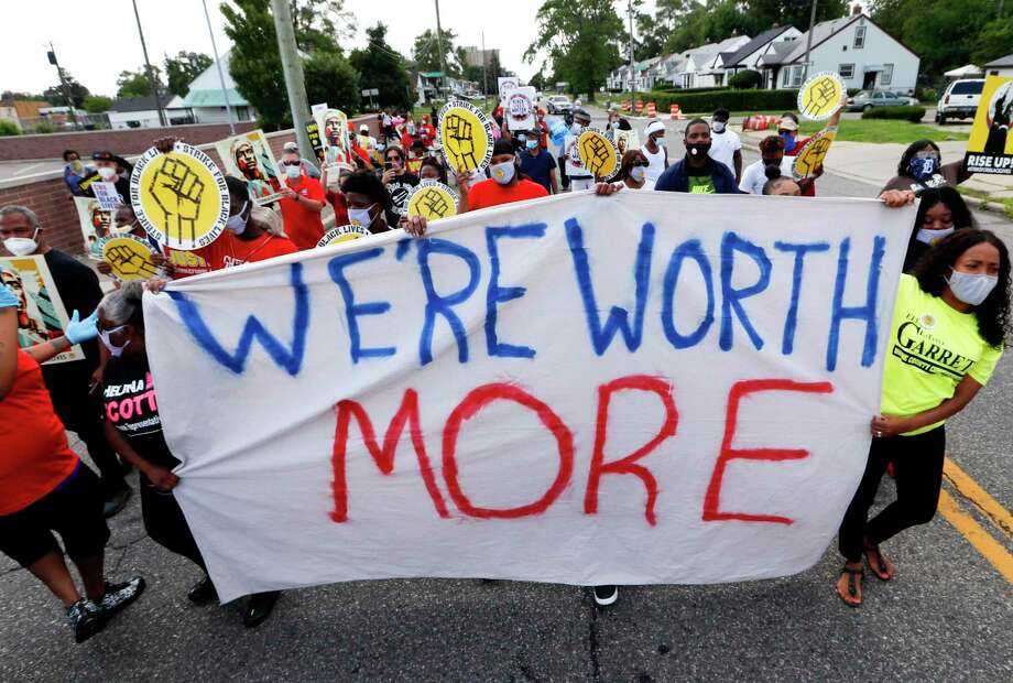 """Protesters march outside a McDonald's in Detroit on July 20. The national workers strike , dubbed the """"Strike for Black Lives,"""" saw people walk off the job Monday in U.S. cities to protest systemic racism and economic inequality. Photo: Paul Sancya / Associated Press / Copyright 2020 The Associated Press. All rights reserved"""