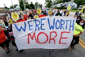 """Protesters march outside a McDonald's in Detroit on July 20. The national workers strike , dubbed the """"Strike for Black Lives,"""" saw people walk off the job Monday in U.S. cities to protest systemic racism and economic inequality."""
