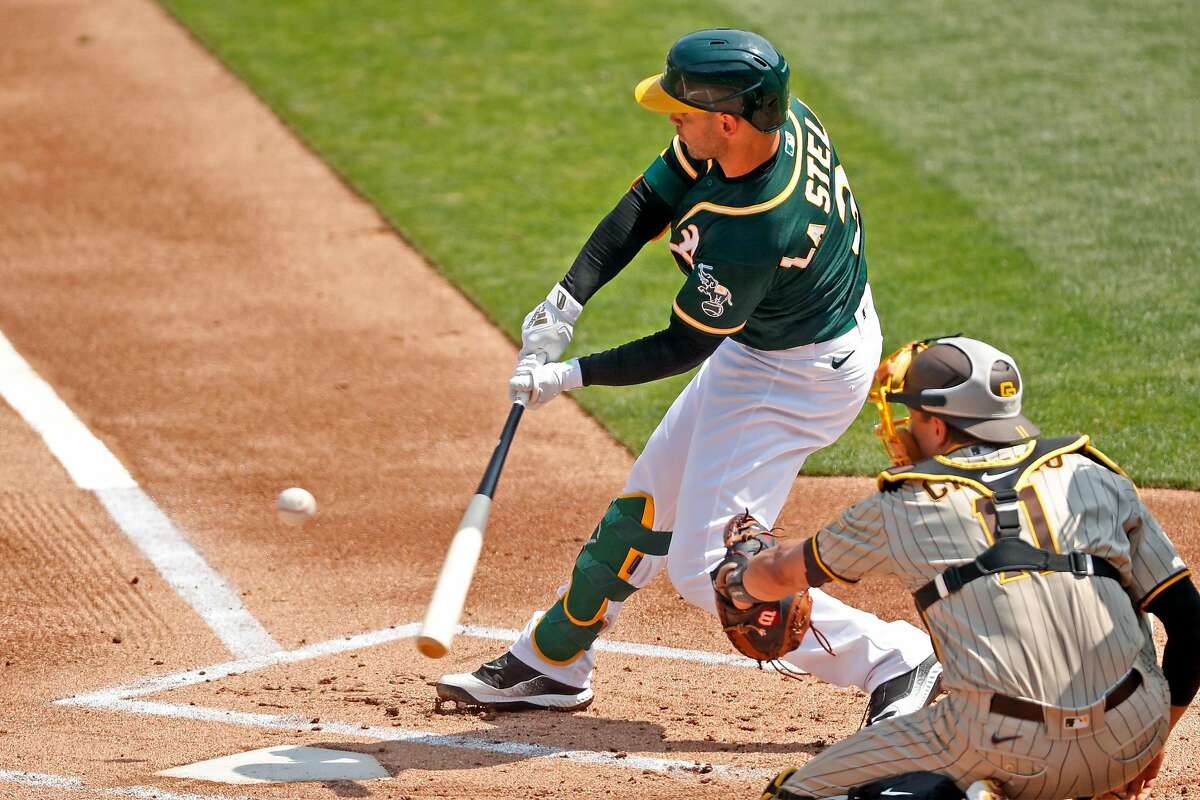 Oakland Athletics' Tommy La Stella doubles in 1st inning against San Diego Padres during MLB game at Oakland Coliseum in Oakland, Calif., on Sunday, September 6, 2020.
