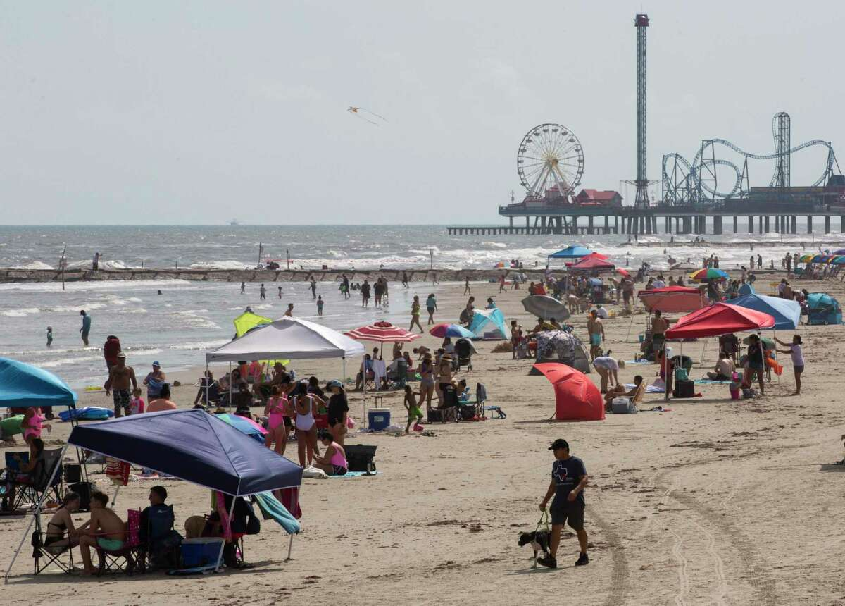 People gather to enjoy the beach at the Galveston Seawall on Labor Day weekend Saturday, Sept. 5, 2020, in Galveston.