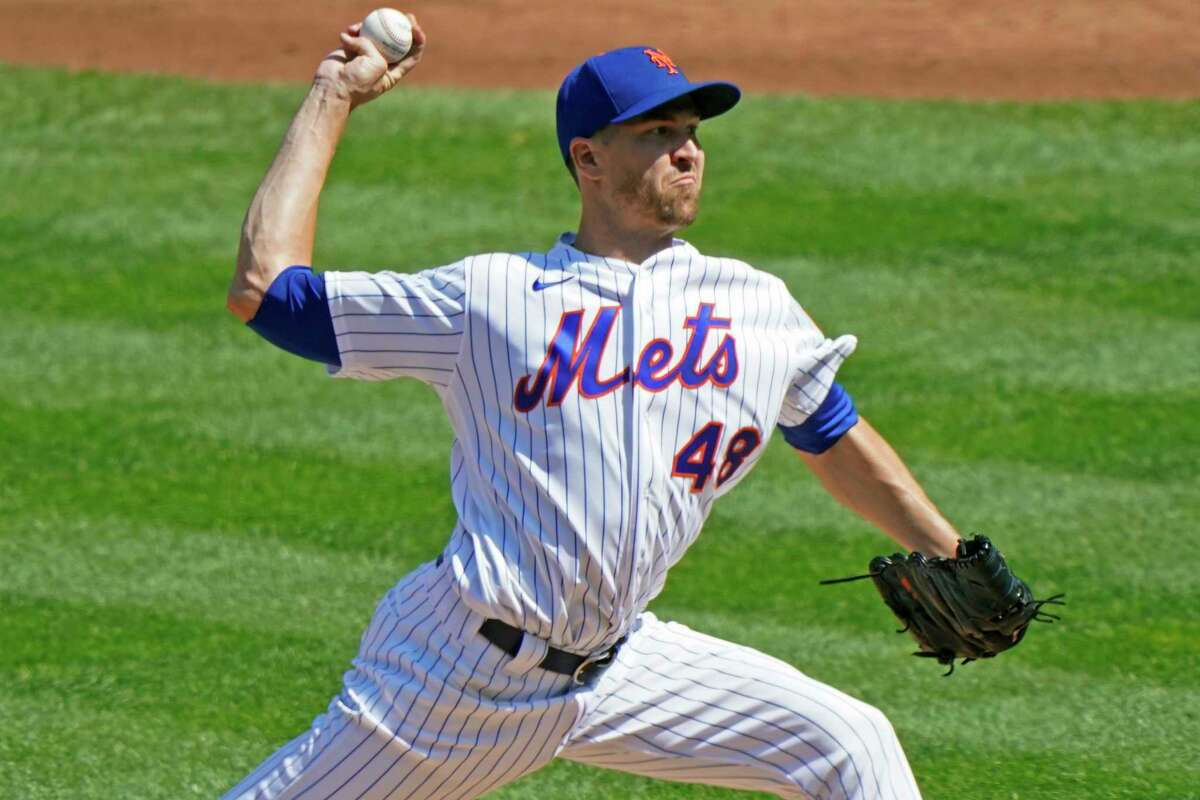 New York Mets starting pitcher Jacob deGrom winds up during the second inning of a baseball game against the Philadelphia Phillies, Sunday, Sept. 6, 2020, in New York. (AP Photo/Kathy Willens)