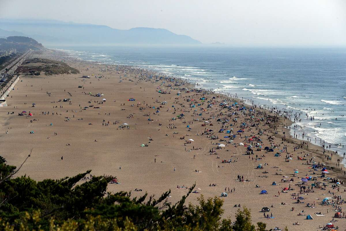 People took advantage of the cooler temperatures at Ocean Beach as the hot weather toppled records all over the Bay Area, with the previous record of 92 easily beat by the high of 100 in San Francisco, Calif., on Sunday, September 6, 2020.