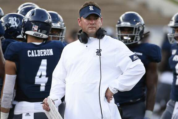 Rice head coach Mike Bloomgren, center, watches from the sidelines during a timeout during the first half of an NCAA college football game against Louisiana Tech, Saturday, Sept. 28, 2019, in Houston.
