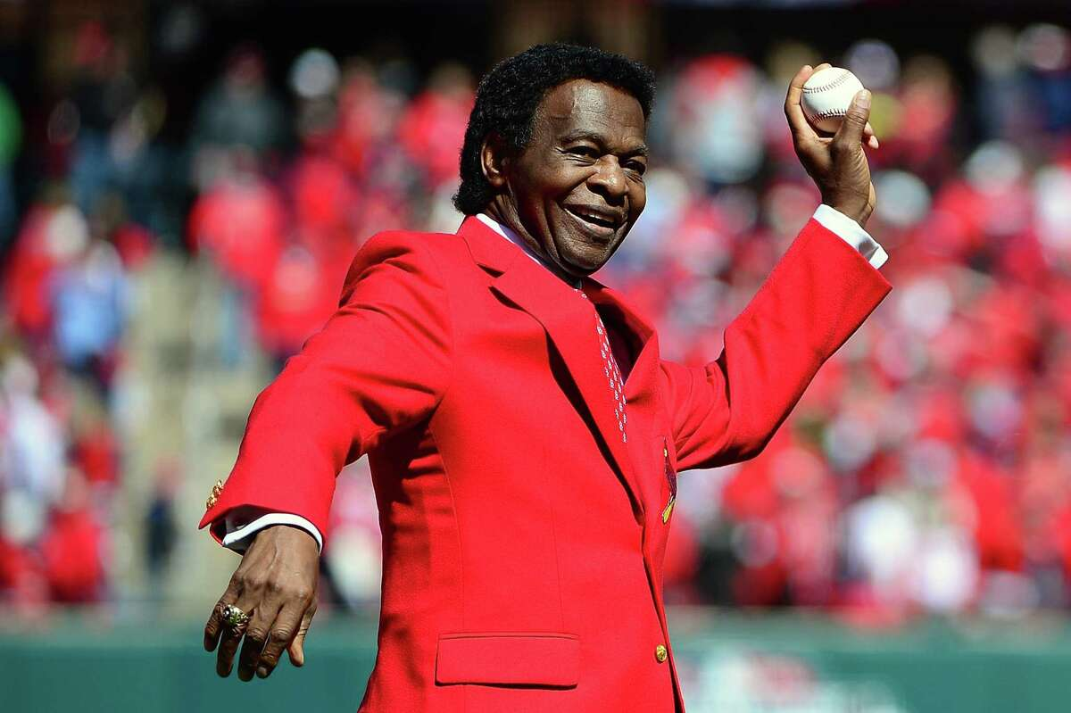 FILE: MLB first-ballot Hall of Famer Lou Brock has died at the age of 81. A six-time all-star, he played on 2 world champion teams and had 3,023 career hits. Brock retired with an MLB-record 938 career stolen bases. ST. LOUIS, MO - APRIL 11: St. Louis Cardinals hall of famer Lou Brock throws out a first pitch before the Cardinals home opener against the Milwaukee Brewers at Busch Stadium on April 11, 2016 in St. Louis, Missouri. (Photo by Jeff Curry/Getty Images)