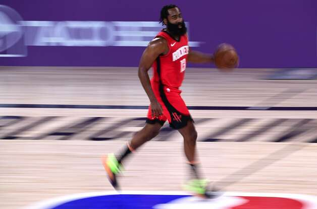 LAKE BUENA VISTA, FLORIDA - SEPTEMBER 06: James Harden #13 of the Houston Rockets dribbles the ball during the first quarter against the Los Angeles Lakers in Game Two of the Western Conference Second Round during the 2020 NBA Playoffs at AdventHealth Arena at the ESPN Wide World Of Sports Complex on September 06, 2020 in Lake Buena Vista, Florida. NOTE TO USER: User expressly acknowledges and agrees that, by downloading and or using this photograph, User is consenting to the terms and conditions of the Getty Images License Agreement. (Photo by Douglas P. DeFelice/Getty Images) Photo: Douglas P. DeFelice/Getty Images / 2020 Getty Images