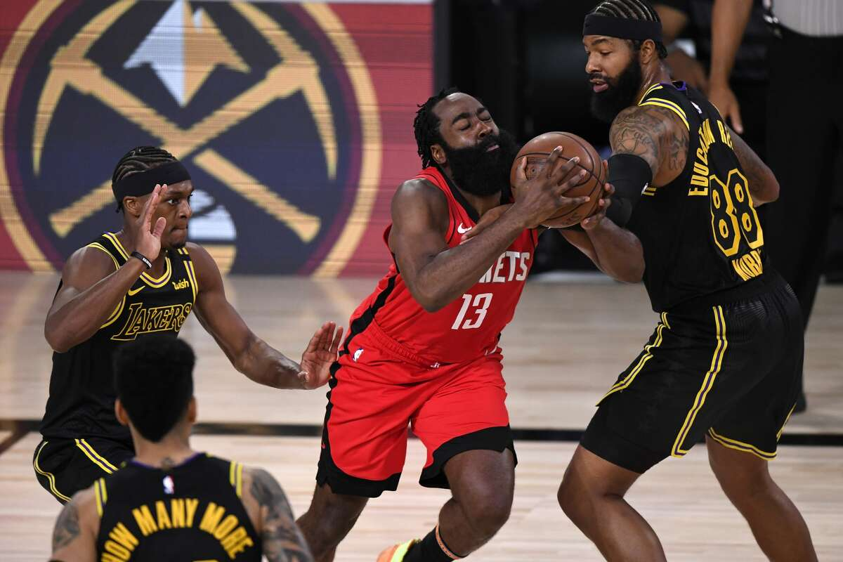 LAKE BUENA VISTA, FLORIDA - SEPTEMBER 06: James Harden #13 of the Houston Rockets drives the ball against Markieff Morris #88 of the Los Angeles Lakers during the second quarter in Game Two of the Western Conference Second Round during the 2020 NBA Playoffs at AdventHealth Arena at the ESPN Wide World Of Sports Complex on September 06, 2020 in Lake Buena Vista, Florida. NOTE TO USER: User expressly acknowledges and agrees that, by downloading and or using this photograph, User is consenting to the terms and conditions of the Getty Images License Agreement. (Photo by Douglas P. DeFelice/Getty Images)