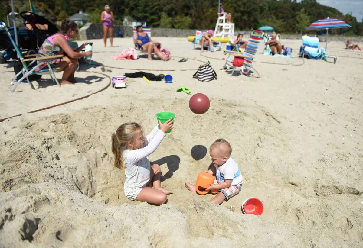 Glenville siblings Sadie Schacter, 3, and Bo Schecter, 1, play on the beach at Byram Park on Sunday. Greenwich saw beautiful weather all weekend with high temperatures in the low-80s.