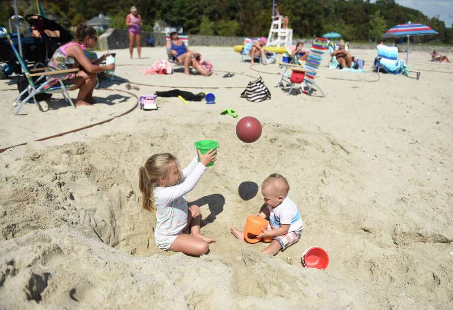 Glenville siblings Sadie Schacter, 3, and Bo Schecter, 1, play on the beach at Byram Park on Sunday. Greenwich saw beautiful weather all weekend with high temperatures in the low-80s. Photo: Tyler Sizemore / Hearst Connecticut Media / Greenwich Time