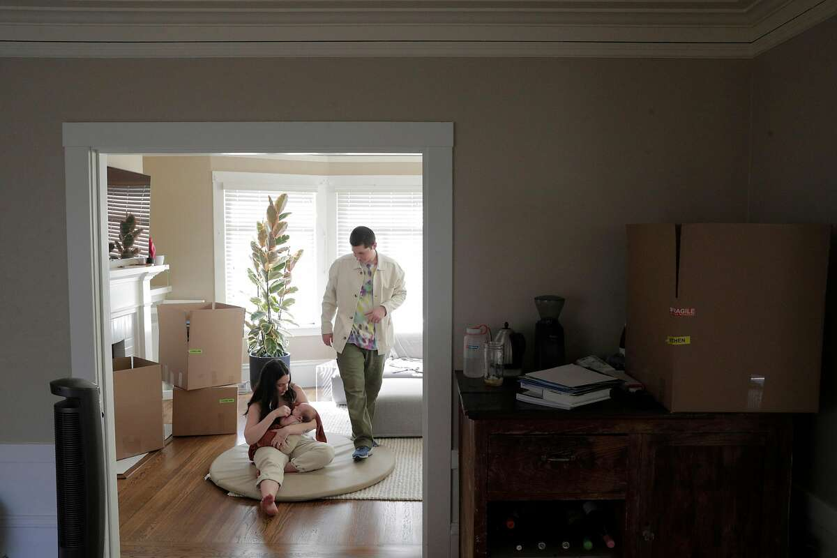 Blake and Erica Johnston with their baby Ellis, packing to move in their apartment in San Francisco, Calif., on Sunday, September 6, 2020. The couple decided to take advantage of the willingness of their employers to work remotely and decided to move to Austin, Texas to be closer to family.