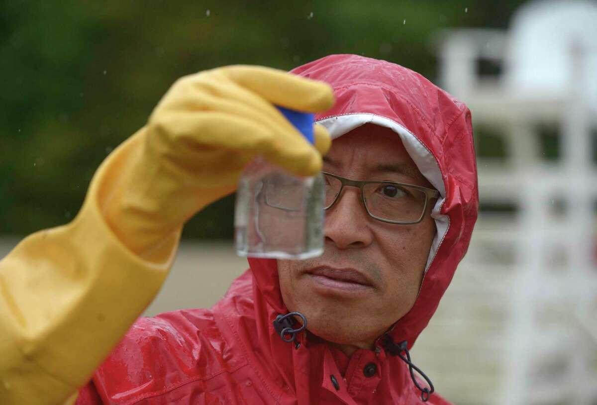 Professor Edwin Wong from Western Connecticut State University monitoring cyanobacteria - also known as blue-green algae - in Lake Zoar in September 2020.