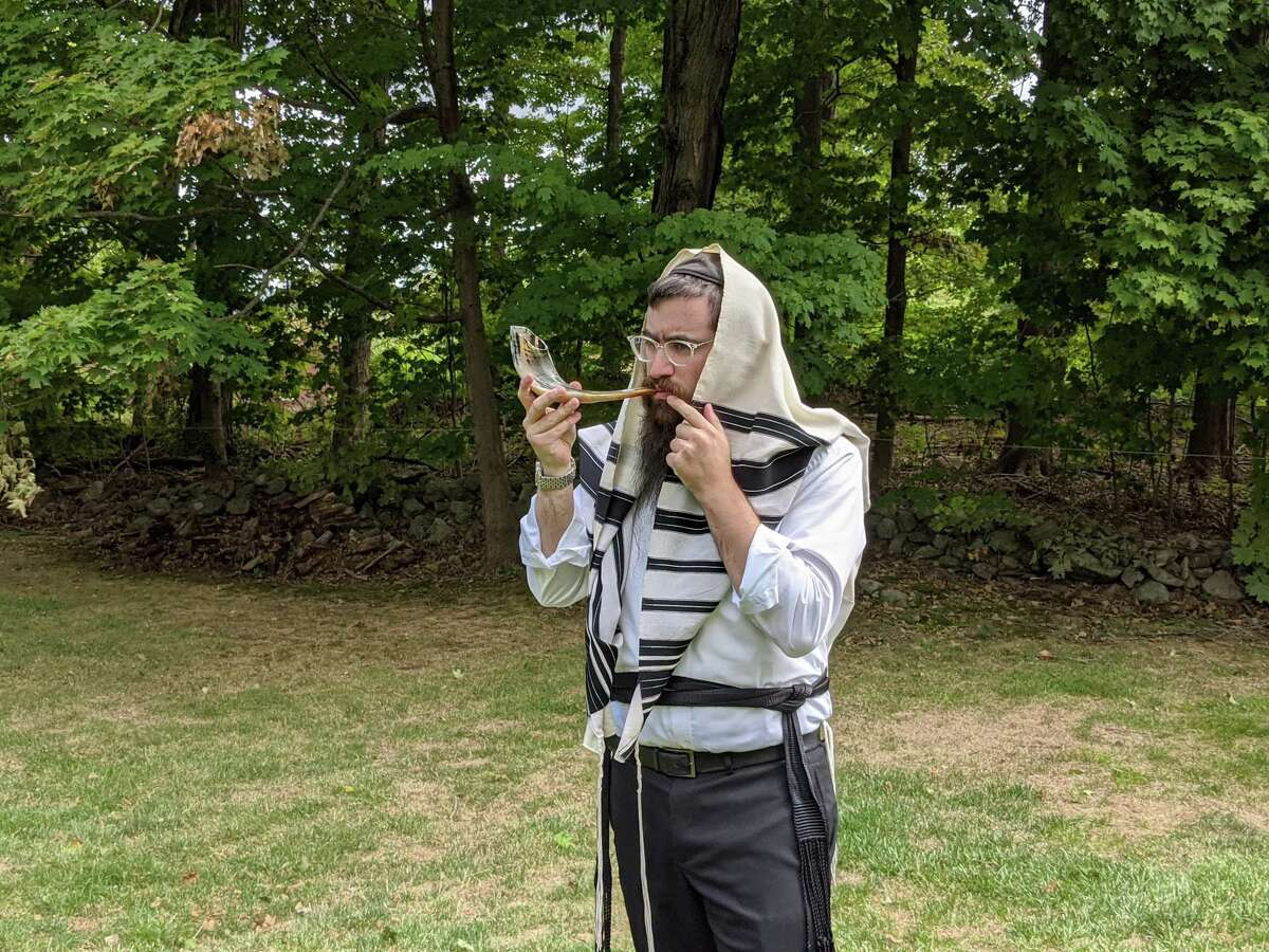 Rabbi Shneur Brook of the Chabad of Shelton and Monroe blowing the shofar. Chabad of Shelton and Monroe will hold an outdoor Rosh Hashanah service on Sunday, Sept. 20, at 4 p.m. on the Huntington Green in Shelton.