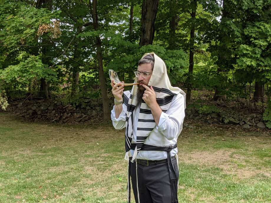 Rabbi Shneur Brook of the Chabad of Shelton and Monroe blowing the shofar. Chabad of Shelton and Monroe will hold an outdoor Rosh Hashanah service on Sunday, Sept. 20, at 4 p.m. on the Huntington Green in Shelton. Photo: Chabad Of Shelton & Monroe / Contributed Photo / Connecticut Post