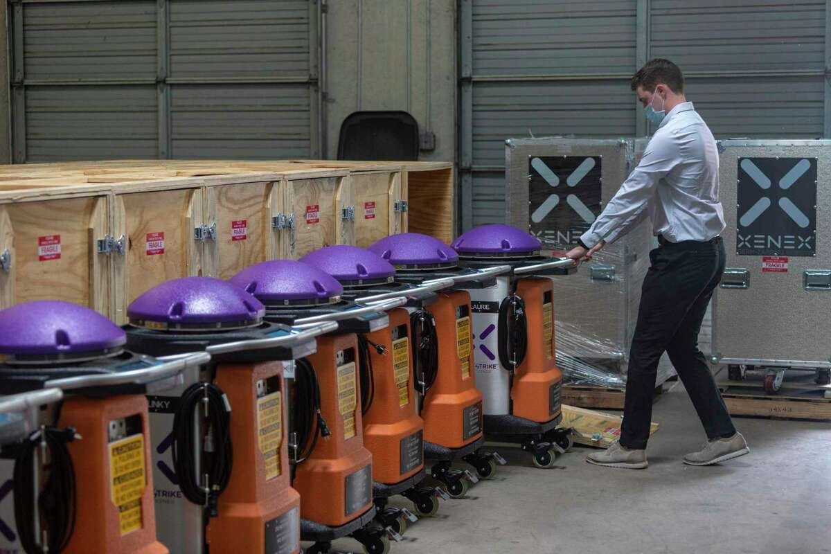 Nick Ward, Xenex materials manager, demonstrates Wednesday, Sept. 2, 2020 how the company's LightStrike xenon-light-emitting disinfecting robots are prepared for shipping to customers.