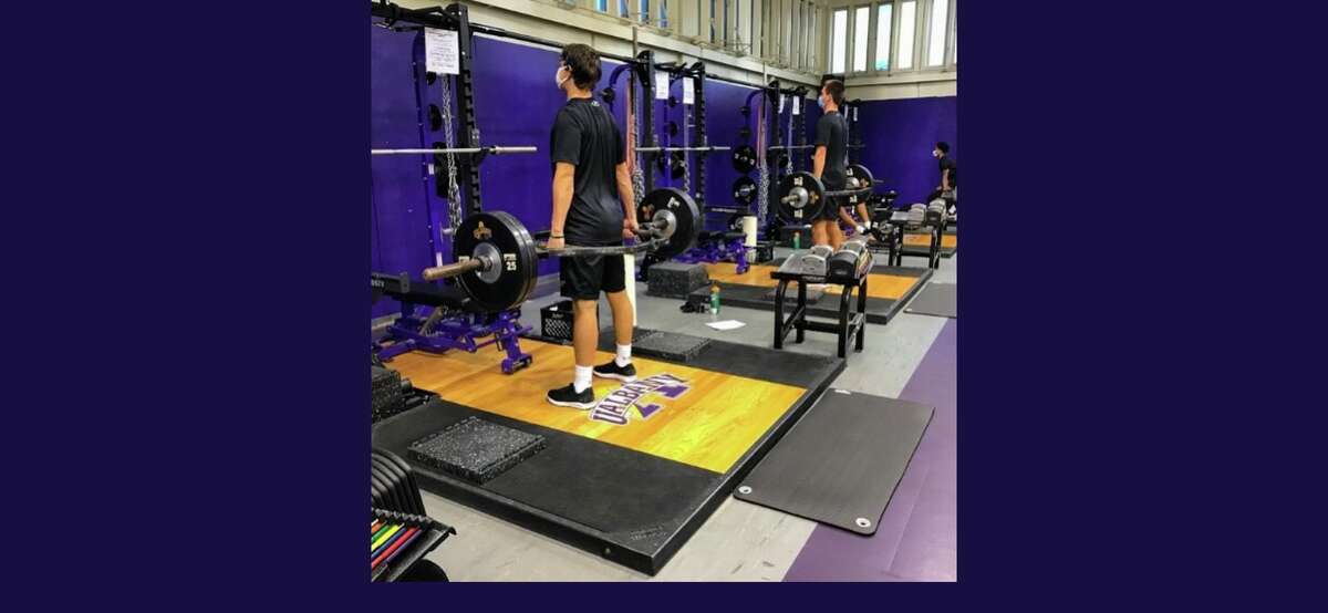 A pair of University at Albany basketball players lift weights on Sept. 7, 2020, the first day organized team activities were allowed. (UAlbany strength Twitter account)