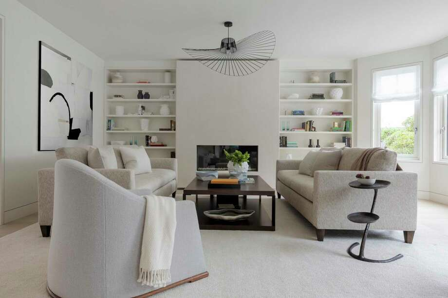 San Francisco-based interior designer Heather Hilliard collaborated on this living room in Cow Hollow, which features built-in display shelves on both sides of a gas fireplace. Photo: David Duncan Livingston / © Dacian Groza