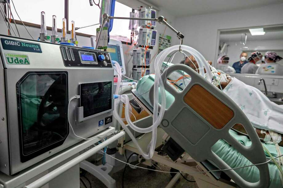 An emergency ventilator is tested on a person in the ICU at San Vicente Fundacion Hospital in Medellin, Colombia on Aug. 13. Laredo doctors are treating ventilators as a last resort for COVID-19 patients due to the complications they can cause as 43% of the virus-related deaths for the city in August were patients on ventilators. Photo: Joaquin Sarmiento /AFP Via Getty Images / AFP or licensors