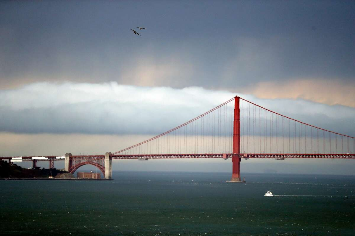 A storm moves behind Golden Gate Bridge as viewed from Alcatraz Island in San Francisco, Calif., on Monday, August 17, 2020. A protest march closed some lanes of the Golden Gate Bridge Monday.