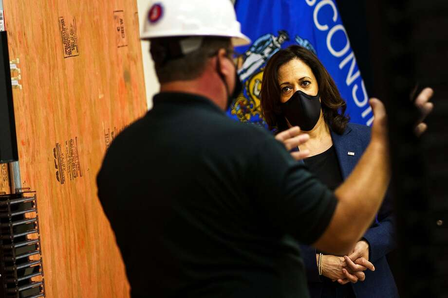 Democratic vice presidential nominee Kamala Harris listens to a worker as she tours an International Brotherhood of Electrical Workers (IBEW) training facility on September 7, 2020 in Milwaukee, Wisconsin. - Harris will visit on September 7, 2020 an International Brotherhood of Electrical Workers (IBEW) Training Facility and speak with IBEW members and Wisconsin labor leadership. (Photo by Kerem Yucel / AFP) (Photo by KEREM YUCEL/AFP via Getty Images) Photo: Kerem Yucel, AFP Via Getty Images