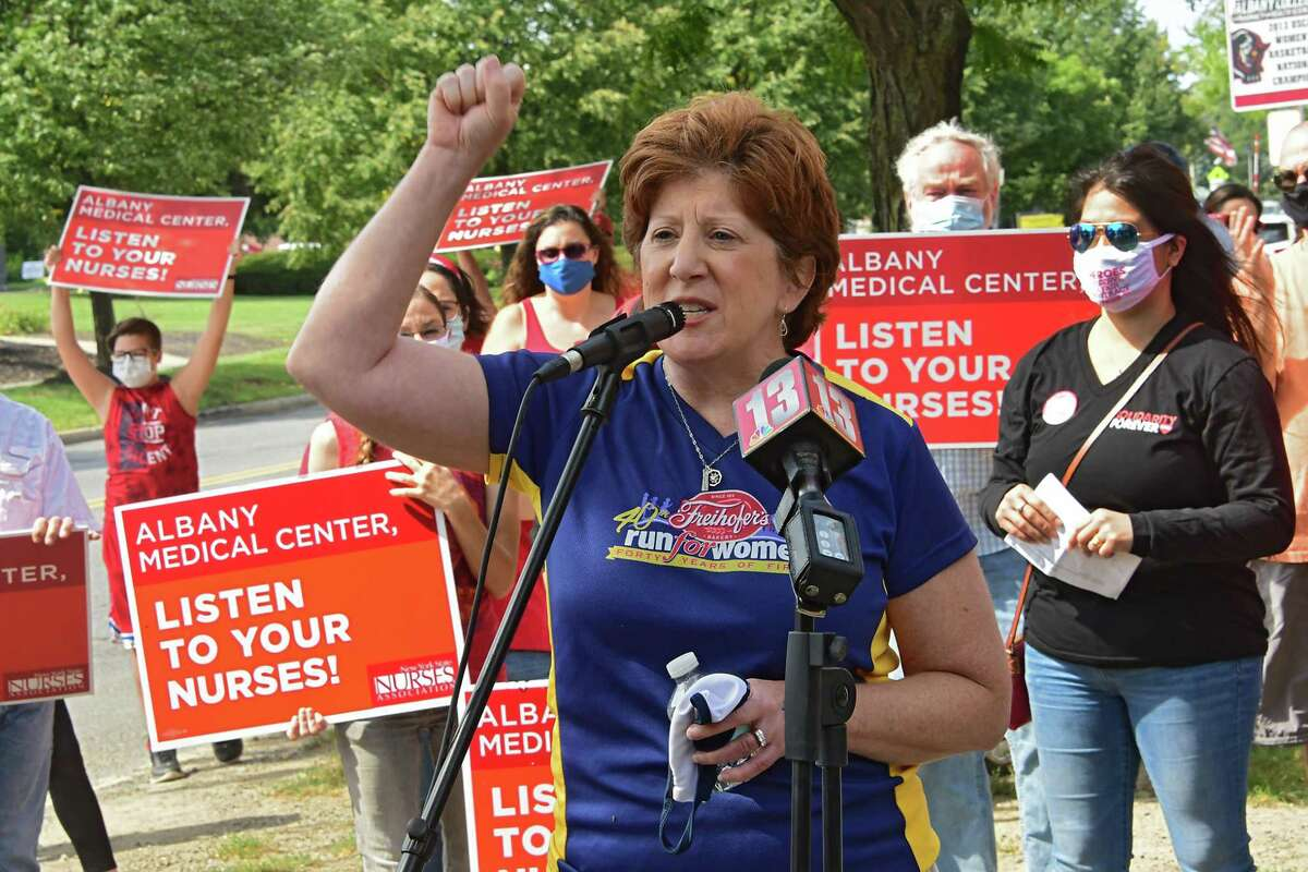 Albany Mayor Kathy Sheehan holds her fist up in solidarity as supporters of New York State Nurses Association rally in front of Albany Medical Center to help nurses fight for a fair contract on Monday, Sept. 7, 2020 in Albany, N.Y (Lori Van Buren/Times Union)