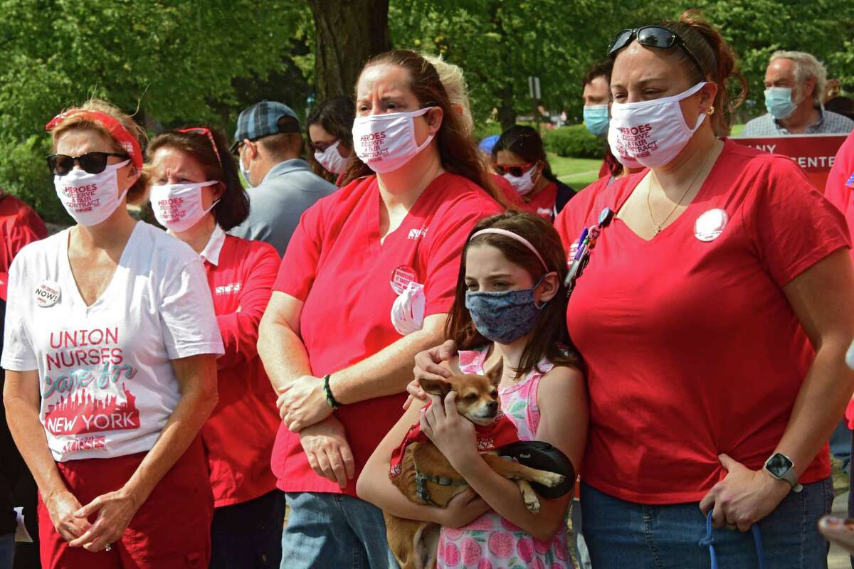 Healthcare workers and their families listen as supporters of New York State Nurses Association speak during a rally in front of Albany Medical Center to help nurses fight for a fair contract on Monday, Sept. 7, 2020 in Albany, N.Y (Lori Van Buren/Times Union)