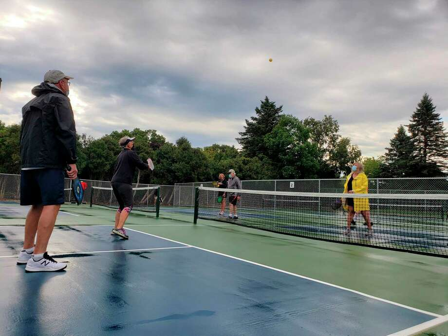The ribbon-cutting event on Saturday at Manistee Township pickleball courts also featured speeches, pickleball-themed cookies, snacks and some rounds of the sport on semi-wet courts after the morning rains subsided. (Arielle Breen/News Advocate)