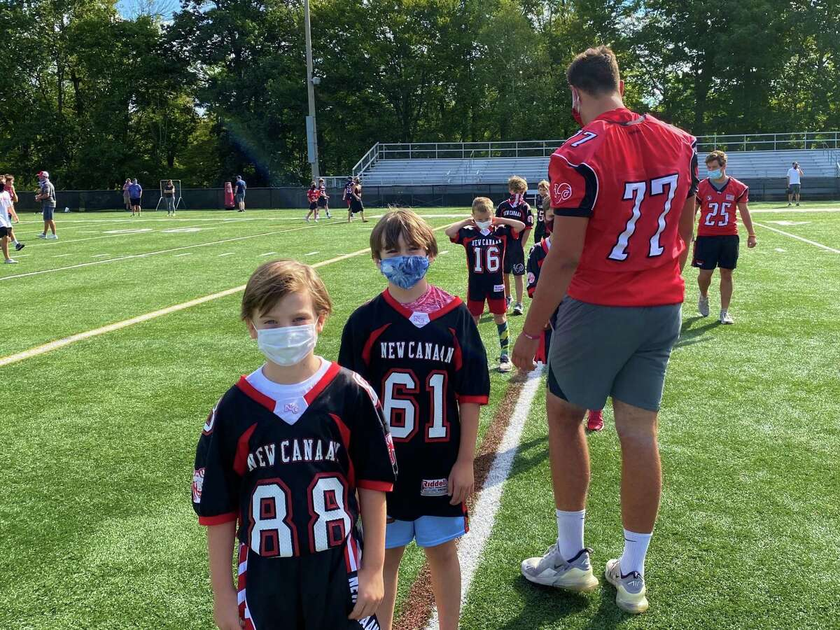 New Canaan football players David Siegel and Jack Connors line up the New Canaan Youth Football 3rd grade team at Dunning Stadium in New Canaan, Conn. on Monday, Sept. 7, 2020.