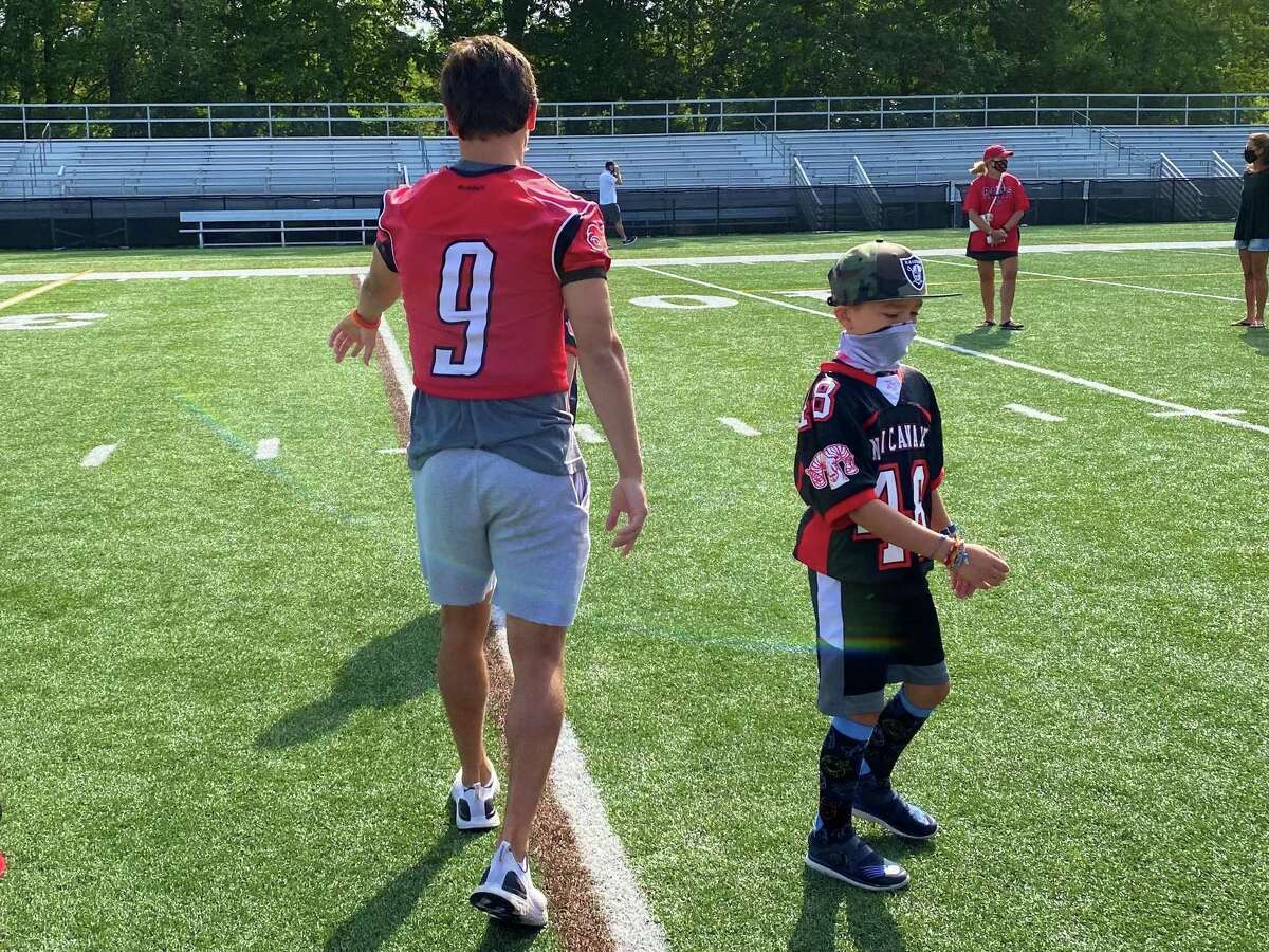 New Canaan senior football player Chris Canet organizes town youth football players at Dunning Field in New Canaan, Conn. on Monday. Sept. 7, 2020.