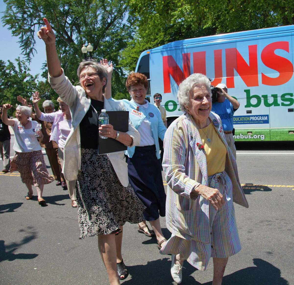 """Sister Diane Donoghue, right, and Sister Simone Campbell, left, lead the way as the the """"Nuns on the Bus"""" arrive on Capitol Hill in Washington, Monday, July 2, 2012, after a nine-state tour to bring stories of hardship to Congress. Sister Simone Campbell is executive director of Network, a liberal Catholic social justice lobby in Washington. (AP Photo/J. Scott Applewhite)"""