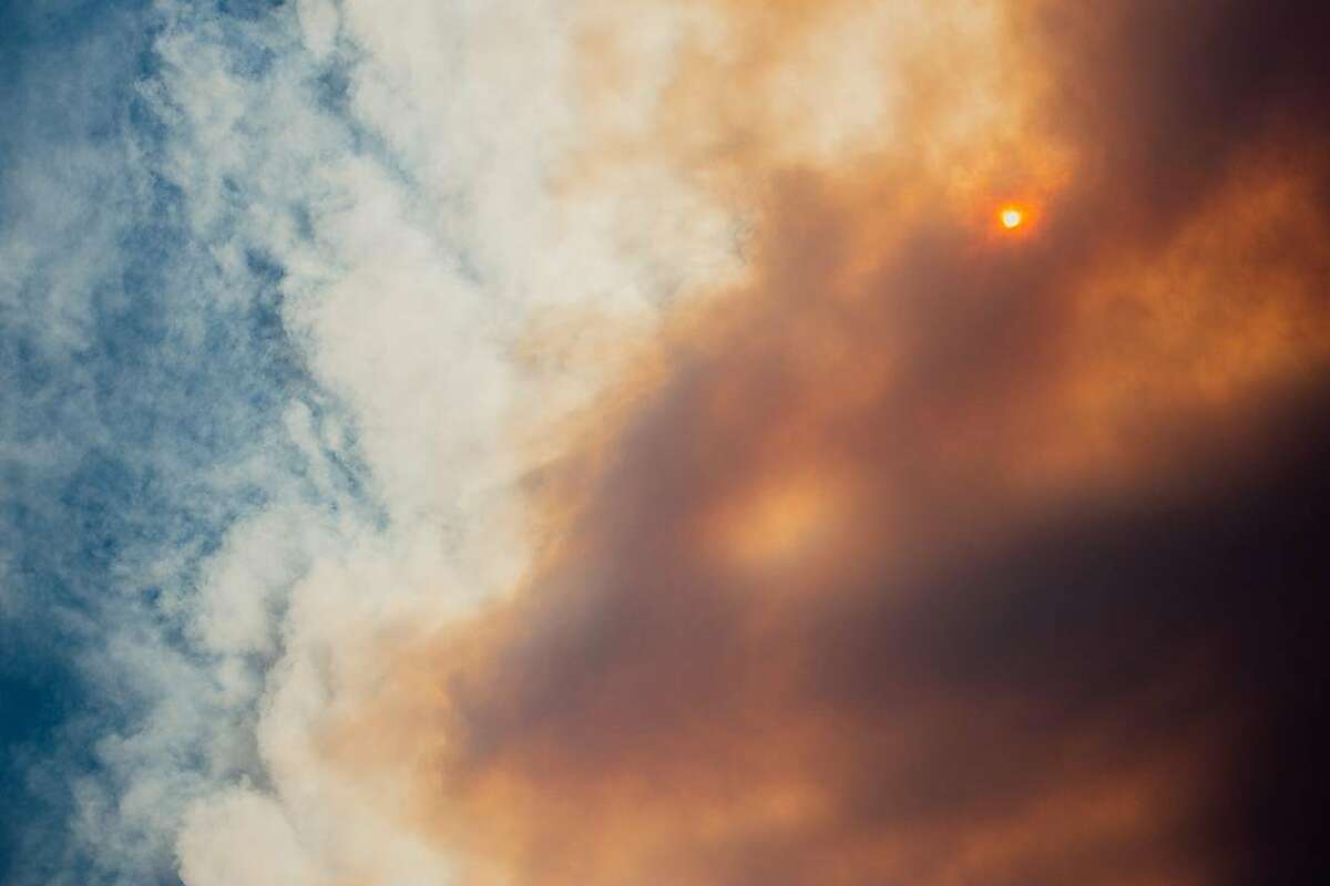 The sky began to darken with smoke from the nearby Creek Fire in the Sierra National Forest in California's Sierra Nevada on Saturday, Sept. 5.