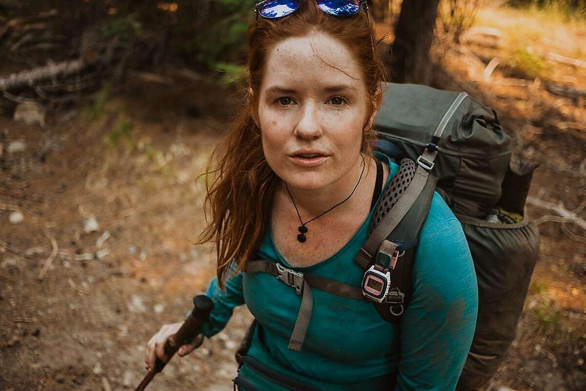 Jaymie Shearer begins a hike with friends in the Sierra National Forest in California's Sierra Nevada on Saturday, Sept. 5.