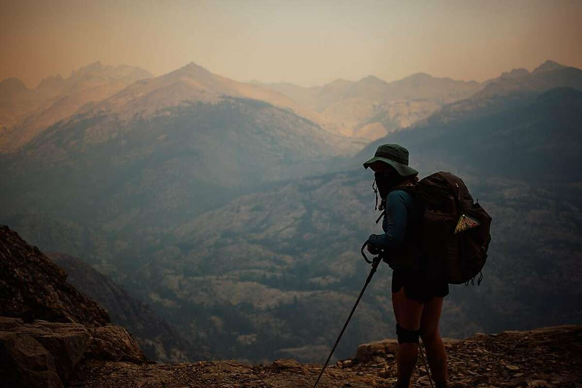 Jaymie Shearer looks out on the Ansel Adams Wilderness in the Sierra National Forest in California's Sierra Nevada on Saturday, Sept. 5.