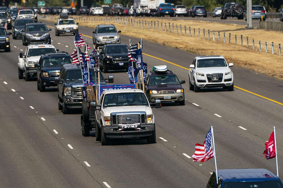 TUALATIN, OR - SEPTEMBER 07: Participants in a pro-Trump vehicle rally drive southbound on Interstate 5 on September 7, 2020 in Tualatin, Oregon. The event, billed as the Oregon For Trump 2020 Labor Day Cruise Rally, began in Clackamas and made its way toward Salem. (Photo by David Ryder/Getty Images)