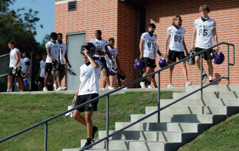 Montgomery football players make their way down to the field for the first day of practice at Montgomery High School, Monday, Sept. 7, 2020, in Montgomery. High Schools programs in 5A and 6A classifications began practices as part of the University of Interscholastic League's phased approach to starting high school athletics across Texas. Photo: Jason Fochtman, Houston Chronicle / Staff Photographer / 2020 © Houston Chronicle
